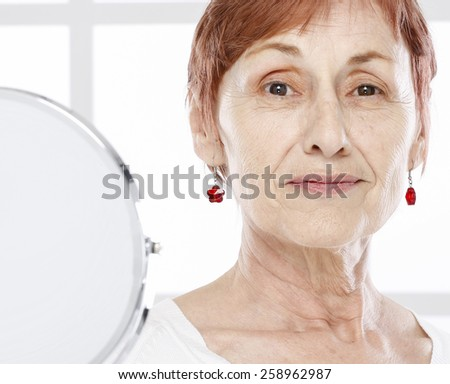 Sixty years old woman and tender - stock photo