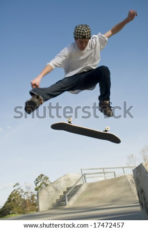 Skate boarder jumping with board flipping - stock photo