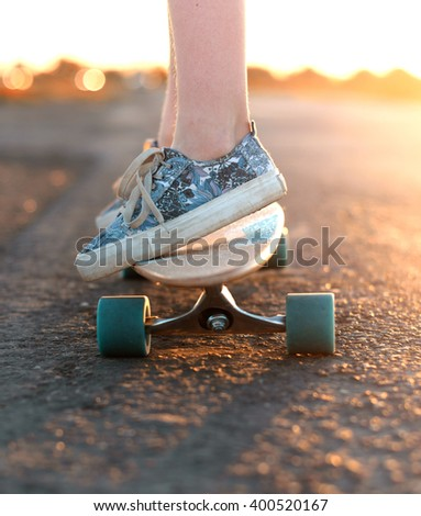 skateboard on the road - stock photo