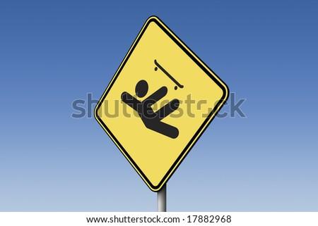 Skateboard sign against blue sky - stock photo