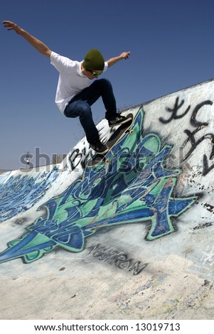 Skateboarder doing trick on ramp - stock photo