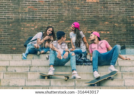 Skateboarder friends on the stairs, made selfie photo - stock photo