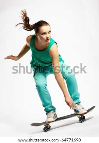 Skateboarder girl skating on skateboard with high speed - stock photo