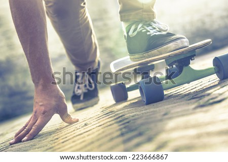 Skateboarder riding skateboard through the streets - stock photo