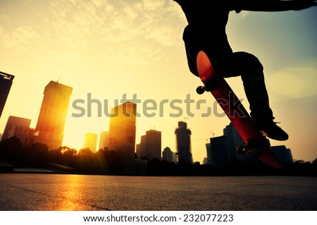 skateboarder skateboarding at sunrise city  - stock photo