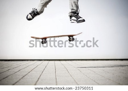 skater making an olli with his skateboard - stock photo