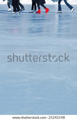 Skaters on ice surface - stock photo