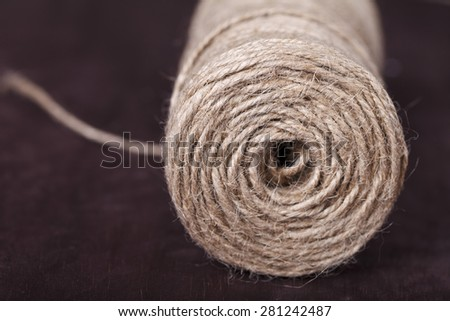 skein of twine on a brown background close-up - stock photo