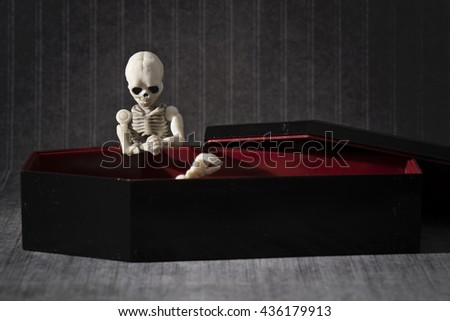 Skeleton arise from the coffin - stock photo