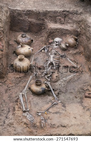 skeleton corpse ruin with old treasures found underground - stock photo