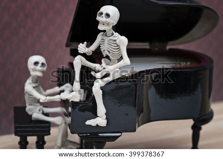 skeleton diva and pianist - stock photo