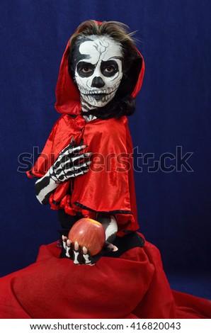 Skeleton Girl in red cape - stock photo