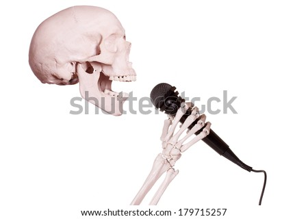 skeleton hand holding microphone - stock photo