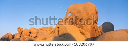 Skeleton Rock and Moon at Sunset, Joshua Tree, California - stock photo
