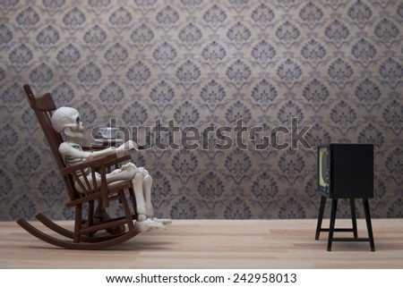 Skeleton - watching tv - stock photo