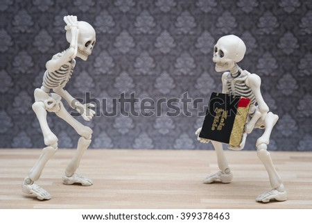 skeletons and heavy bible - stock photo