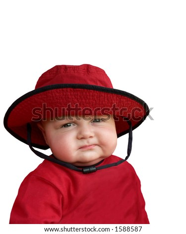 Skeptical baby in red hat. - stock photo