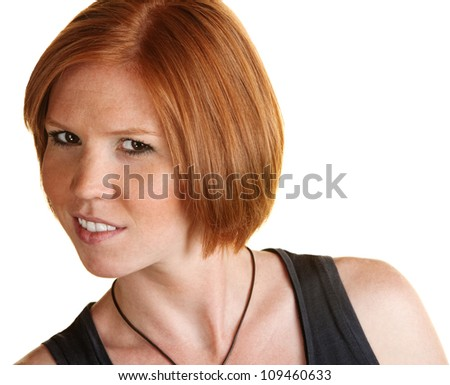Skeptical female leaning over with grin over white background - stock photo