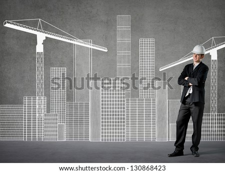 Sketch of a growing city on a wall - stock photo