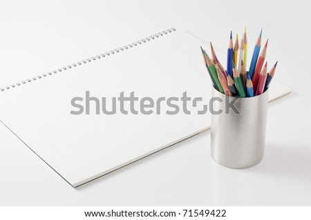 Sketchbook and colored pencils. - stock photo
