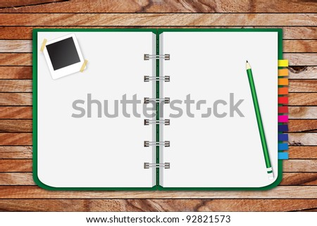 sketchbook with a lot of photos on wooden floor - stock photo