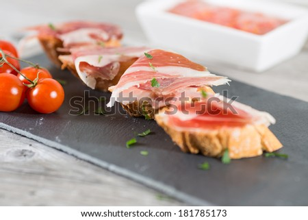 Skewer iberico ham with his bread with tomato - stock photo