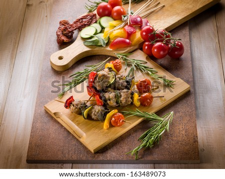 skewer with meat balls and vegetables - stock photo