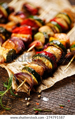 Skewers of chicken meat and vegetables - stock photo