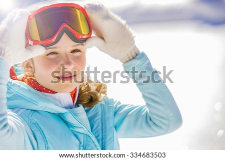 Ski, beautiful and young skier girl enjoying winter vacation - stock photo