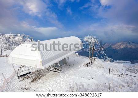 Ski chair lift is covered by snow in winter,Deogyusan mountains in South Korea. - stock photo