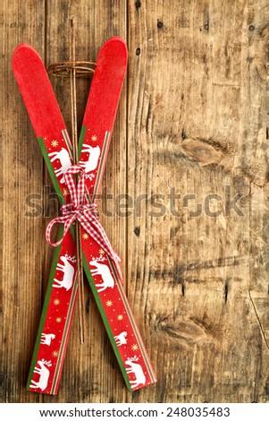 ski decor, alpine ski, alpine menu, copy space, rustic backround,red ski,holiday resort - stock photo