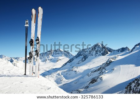 Ski equipment in high mountains in snow at winter - stock photo