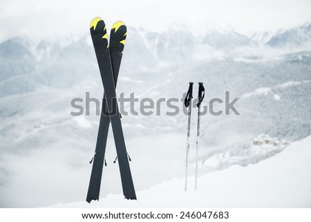 Ski equipment in the snow - stock photo
