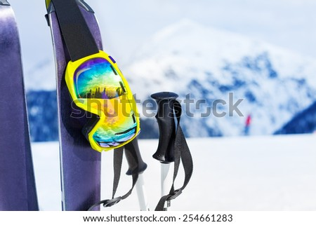 Ski equipment with skies mask and polles - stock photo