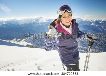 Ski. Funny female skier on the background of high snow-capped Alps in Swiss - stock photo