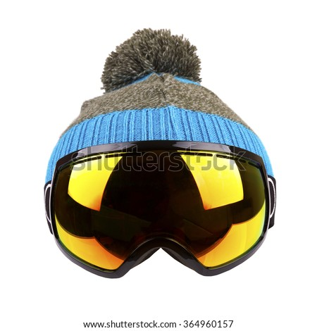 ski goggles and woolen hat isolated on white - stock photo