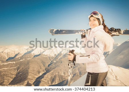 Ski. Happy female skier on the background of high snow-capped Alps in Swiss. Healthy lifestyle and outdoor activity - stock photo