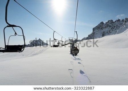 Ski lift in Italian Dolomite - stock photo