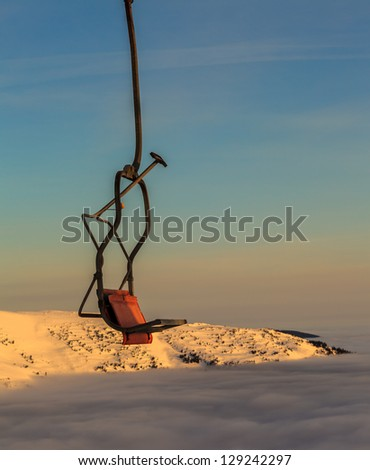 Ski lift on bright winter day - stock photo