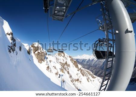 Ski lift panorama on winter resort over valley - stock photo