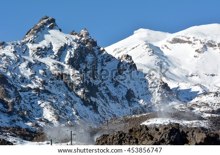 Ski lift to Mount Ruapehu ski field. It's the highest mountain in the North Island of New Zealand (2020m above sea level) located in Tongariro National Park. - stock photo