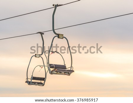 ski lift with seats over the snow mountain in ski resort in mt hood area. - stock photo