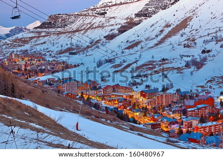 Ski resort in French Alps at dusk - stock photo