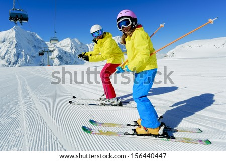 Ski, ski resort, winter sports - family on ski vacation - stock photo