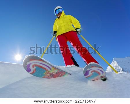 Ski, Skier, Freeride in fresh powder snow - woman skiing - stock photo
