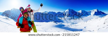 Ski, skier, snow and fun - family enjoying winter vacations - stock photo