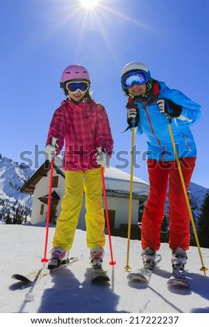 Ski, skier, snow and fun - skiers enjoying winter vacations - stock photo