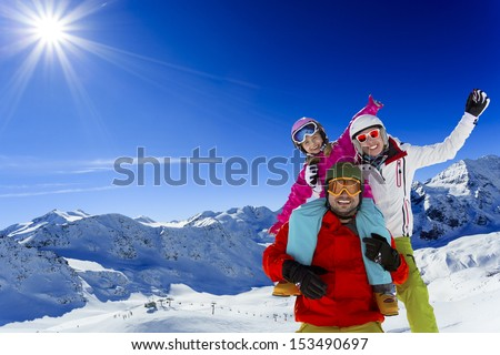 Ski, skier, sun and winter fun - family skiers  enjoying winter holidays - stock photo