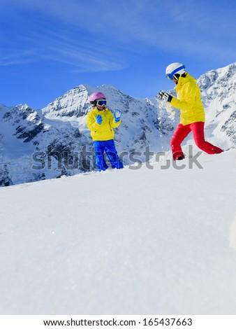 Ski, skier, sun and winter fun - skiers enjoying winter holidays - stock photo