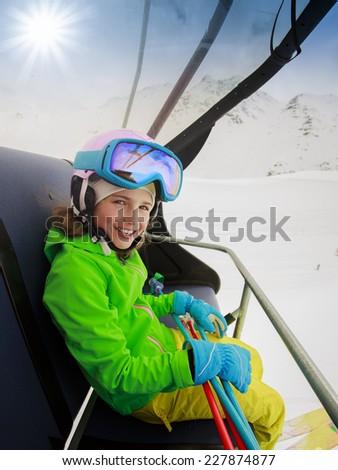 Ski, skiing - lovely skier on ski lift - stock photo